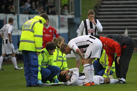 Steven Bell injured at Cappielow Park
