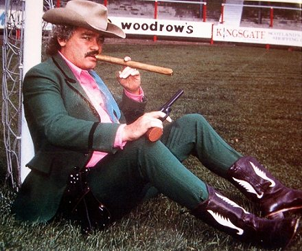 Jim Leishman in boots with cigar